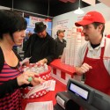 Marcus Haizlip, general manager at the new Five Guys Burger and Fries in Santa Rosa takes the order of Alissa De La Riva, Feb. 15, 2011 | Crista Jeremiason, PD