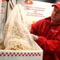 Tom Leugers, co-owner at the new Five Guys Burger and Fries in Santa Rosa, refills the peanut bins for customers, Feb. 15, 2011 | Crista Jeremiason, PD