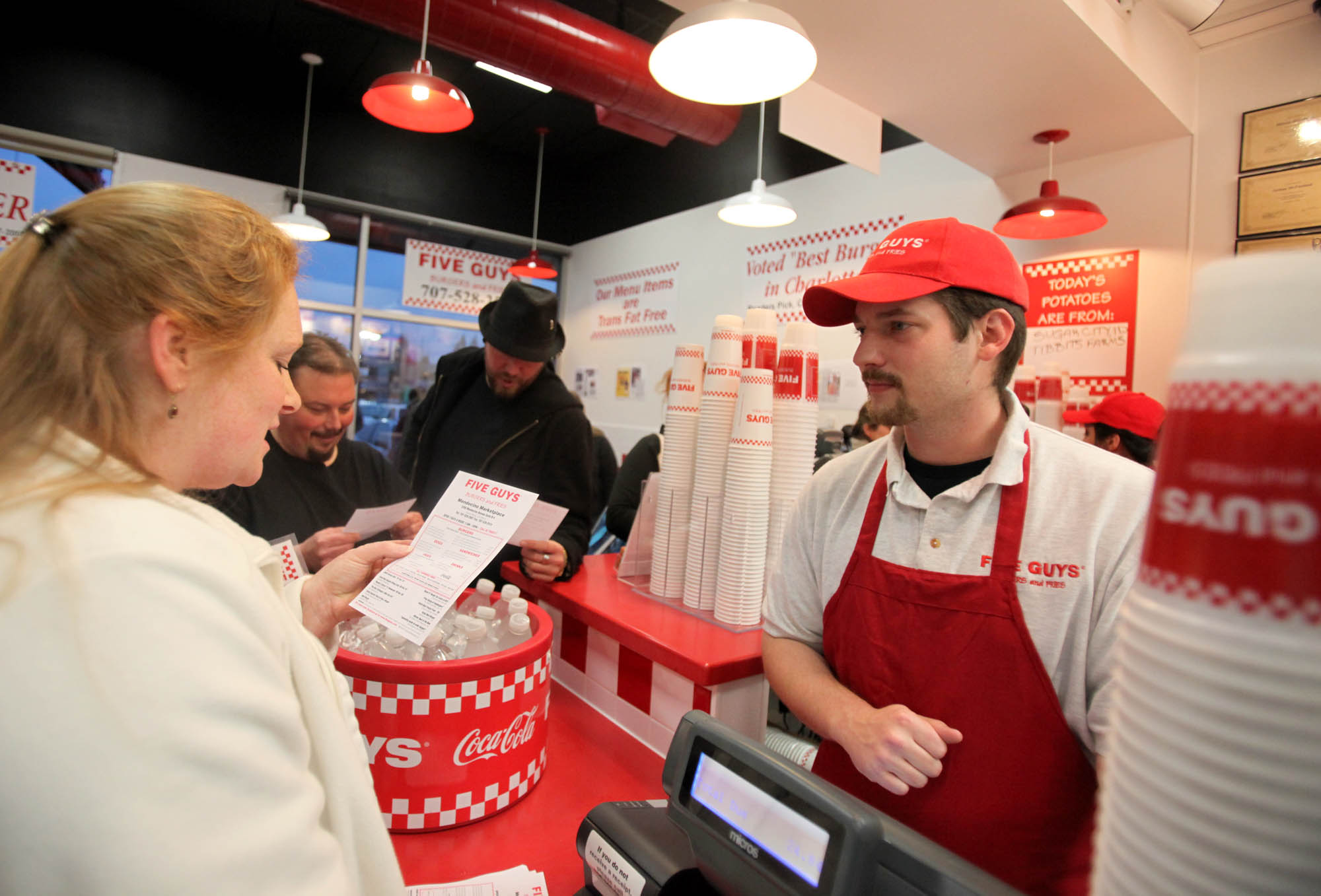 Marcus Haizlip, general manager at the new Five Guys Burger and Fries in Santa Rosa takes the order of Jennifer Marinace, Feb. 15, 2011The location the potatoes come from is posted on the board daily at the new Five Guy's Burger and Fries in Santa Rosa, Feb. 15, 2011| Crista Jeremiason