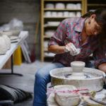 Ceramics artist Amy Halko working in her home studio near Lake Sonoma. (photo by Erik Castro)
