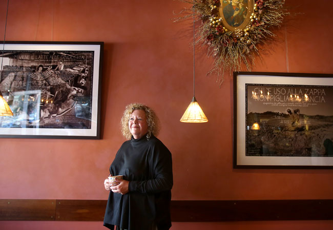 Kathleen Weber, co-owner of Della Fattoria in Petaluma, enjoys the welcoming aspect of the holidays spent with family and friends. (Christopher Chung/ The Press Democrat)