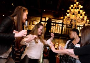 Jenny Chesley, left, Emilie Leen, and Shari Jackson dance during the Sonoma Magazine launch party at Buena Vista Winery, in Santa Rosa, Calif., on November 7, 2013. (Alvin Jornada / The Press Democrat)