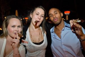 Emilie Leen, left, Jenny Chesley, and Harold Robinson enjoy hand-rolled cigars during the Sonoma Magazine launch party at Buena Vista Winery, in Santa Rosa, Calif., on November 7, 2013. (Alvin Jornada / The Press Democrat)
