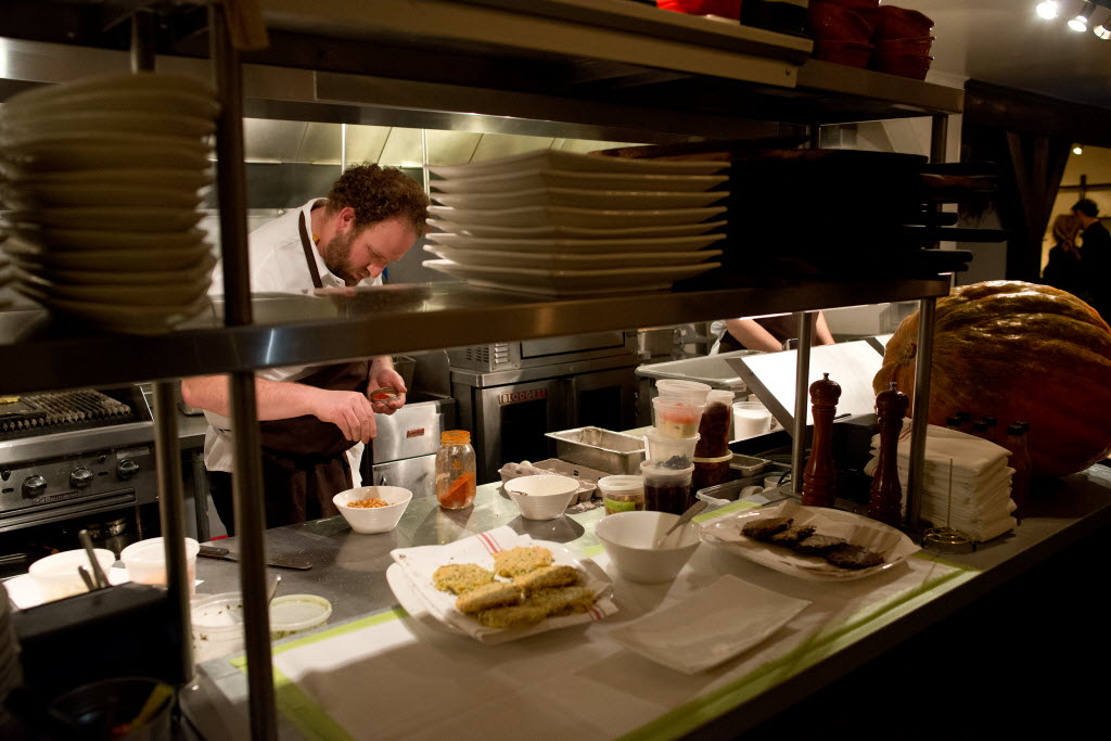 Chef Daniel Kedan prepares an apple compote to accompany yukon gold and purple potato latkes at Backyard restaurant in Forestville, Calif., on November 14, 2013. (Alvin Jornada / The Press Democrat)  Hannukah Latkes at Backyard Restaurant