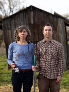 "Ellen Cavalli and Scott Heath, striking their best ""American Gothic"" pose, are in the second year of production of their Tilted Shed Ciderworks, north of Sebastopol. (photo by Christopher Chung)"