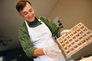 Guy Daniels with Gandolf's Fine Chocolates prepares his boutique truffles in Santa Rosa. (photo by Conner Jay)