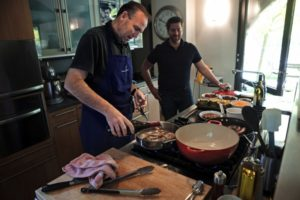 Chef Charlie Palmer deglases his cooked pheasant at his house with Dustin Valette, chef at Dry Creek Kitchen. (photo by Chris Hardy)