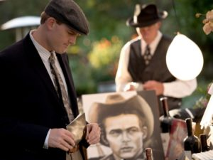 Andrew Cameron browses silent auction items during the National Alliance on Mental Illness (NAMI) Sonoma County Gatsby Gala at the McDonald Mansion, in Santa Rosa, Calif., on September 21, 2013. (Alvin Jornada / The Press Democrat)
