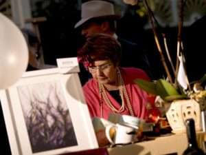 Dana May Casperson browses silent auction items during the National Alliance on Mental Illness (NAMI) Sonoma County Gatsby Gala at the McDonald Mansion, in Santa Rosa, Calif., on September 21, 2013. (Alvin Jornada / The Press Democrat)