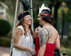 Rose Martini, left, and Jennifer Ibello share a laugh during the National Alliance on Mental Illness (NAMI) Sonoma County Gatsby Gala at the McDonald Mansion, in Santa Rosa, Calif., on September 21, 2013. (Alvin Jornada / The Press Democrat)