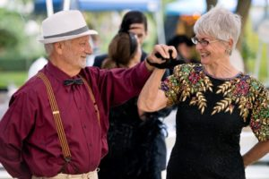 Larry Haenel and Jeanne Marie Manning have fun on the dance floor during the National Alliance on Mental Illness (NAMI) Sonoma County Gatsby Gala at the McDonald Mansion, in Santa Rosa, Calif., on September 21, 2013. (Alvin Jornada / The Press Democrat)
