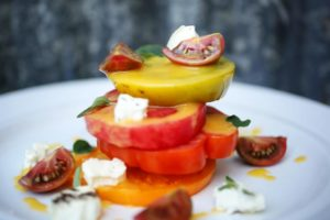 Executive chef John Toulze prepares an heirloom tomato salad at The Girl and the Fig in Sonoma. (Conner Jay/The Press Democrat)