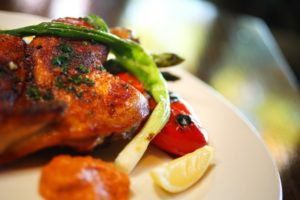 Chicken mattone is served at the Rustic restaurant at Francis Ford Coppola Winery. (Conner Jay/The Press Democrat)