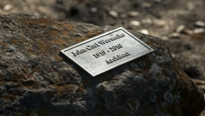 Plaque mounted on a rock at the ranch. Warneckes ashes are buried underneath. (photo by Chris Hardy)