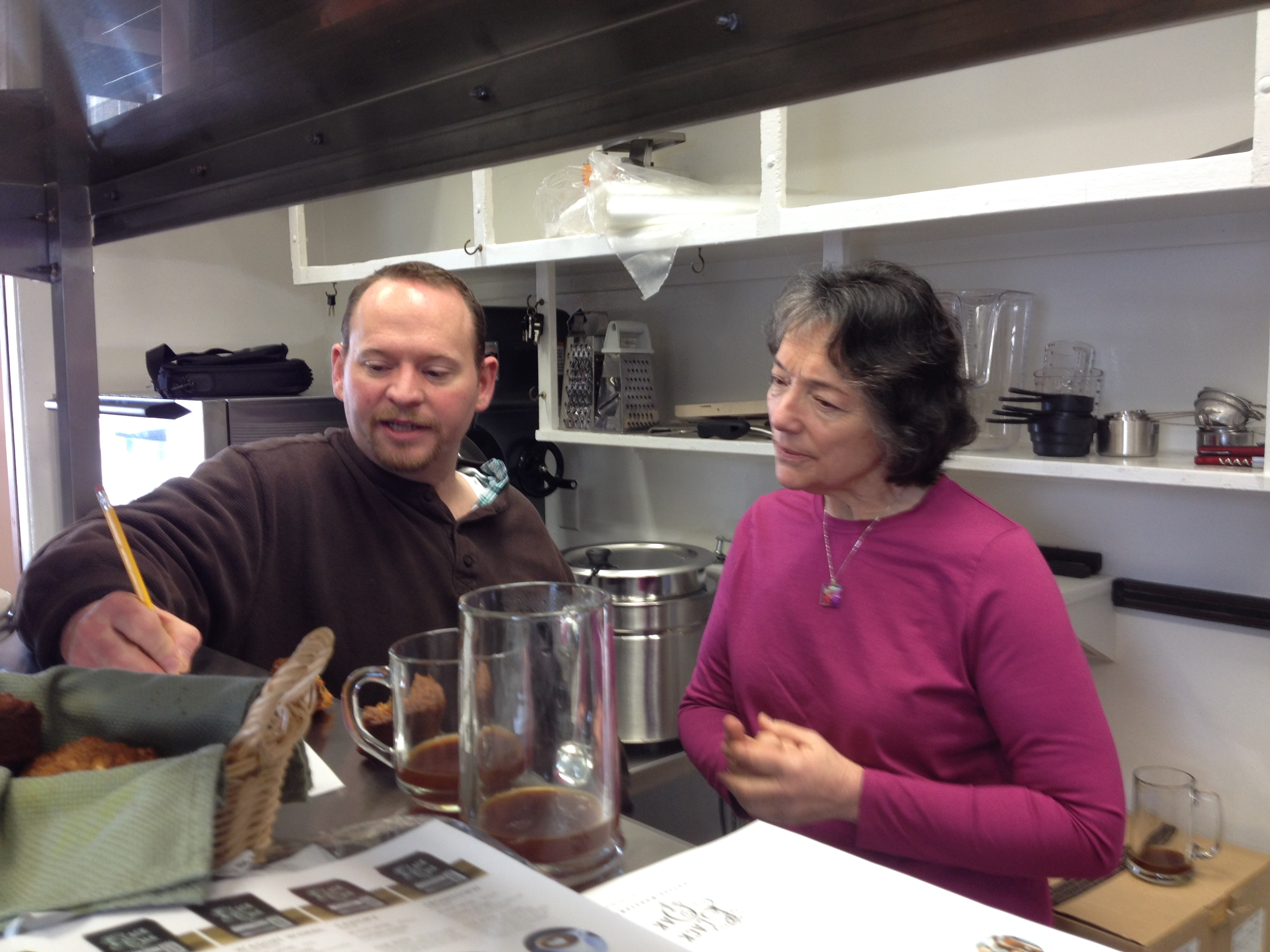 TRILLIUM CHEF JEREMY BAUMGARTNER CONSULTS WITH SUPPORTER MARGARET FOX