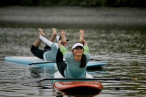 Aluxa Lalicker of Clavey Paddlesports participates in a yoga paddleboard demonstration during the annual Day on the River event at Foundry Wharf in downtown Petaluma. (photo by Ramin Rahimian)