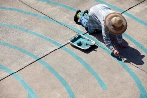 Joanne Page helps paint the Santa Rosa Labyrinth, designed by Lea Goode-Harris, in the courtyard of Christ Church United Methodist, in Santa Rosa.