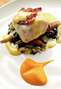 Bacon poached swordfish, with a back 'chip', bacon bernaise and black trumpets made by chef Dustin Valette. (Crista Jeremiason / The Press Democrat, file 2013)