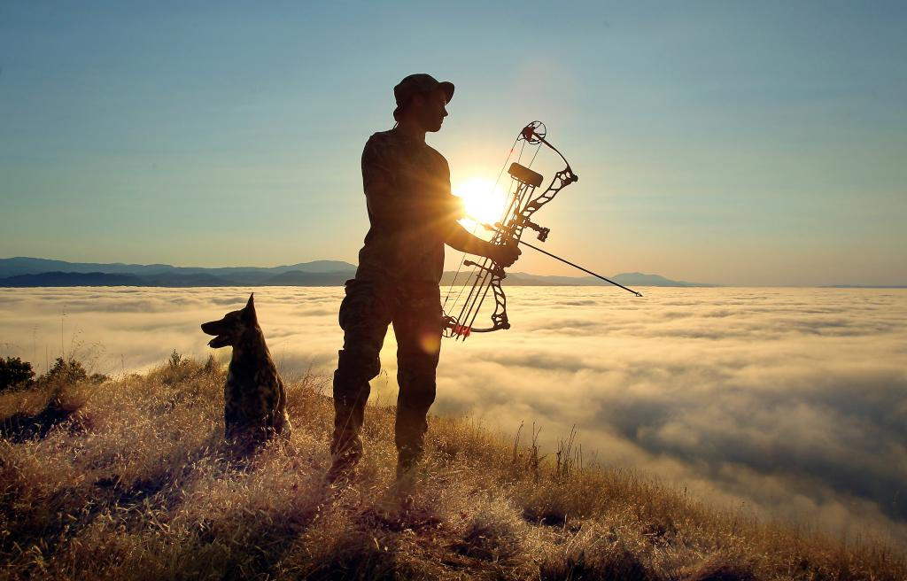 Jayson Collard, with his dog, Maliki, guides hunters into land above Lake Sonoma for hunting wild pigs. (photo by John Burgess/The Press Democrat)