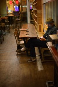"""A bar patron enjoying a glass of red wine before a free screening of Alfonso Cuarón's film """"Gravity""""."""