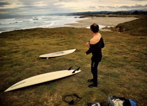 Daniel Arreguin sheds his wetsuit after a winter surfing session at Fort Bragg.