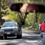 Cyclists and vehicles maneuver for room on narrow West Dry Creek Road. (photos by John Burgess)