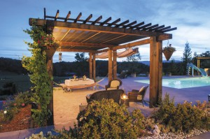 The arbor is a favorite setting for poolside dining and conversation, with a sandbox floor made for wiggling toes.