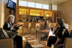 Helen Dunn, left, Carolyn Rausch and Nancy Lyons chat over cocktails in the bar at Prelude.