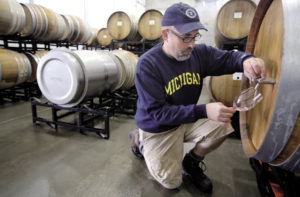 Scot Covington, whom Edwards mentored, samples wine from a barrel at Trione Vineyards and Winery in Geyserville. Covington has made wine with the Trione family since 2005.