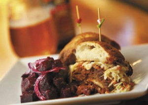 The pulled pork sandwich comes with a side of beet salad from chef Jeff Young of Twist in Forestville. (John Burgess)