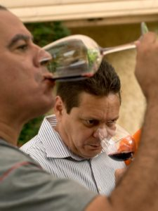 Sommeliers Orlando Pe'alver, left, and Orlando Blanco taste a Klinker Brick 2012 Old Ghost old vine zinfandel from Lodi during the Cuban Sommelier Summit at Ramekins in Sonoma. (photo by Alvin Jornada)
