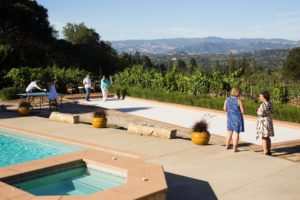 Guests play games and take in the view of the surrounding hills in Daryl and Lisa Groom's backyard.