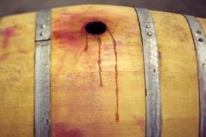 Spilled wine stains a barrel at Punchdown Cellars in Santa Rosa on Thursday, July 17, 2014. (Conner Jay/The Press Democrat)