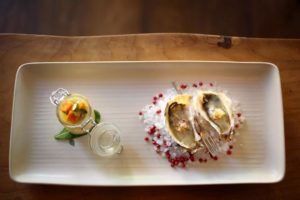 Oysters with white verjus and pickled cucumber are served with a yellow tomato panna cotta and local clams at Partake by K-J restaurant in Healdsburg. (Conner Jay/The Press Democrat)