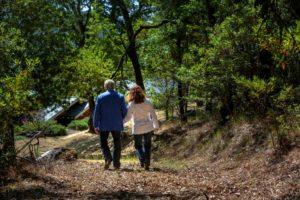Sam and Robin Sebastiani walk down the old quarry road that runs through the backyard to their home.