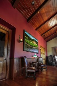 Dining room with ceiling and wainscoting made from old redwood barrels from Sebastiani winery.