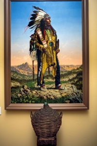 American Indian painting and antique wine bottle in the entry way of the Sebastiani home.