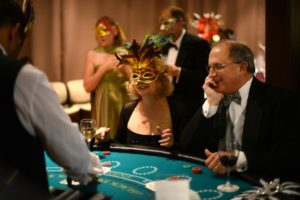Kim McEachron (left) and John Evans at the black jack table during the 18th annual 4-A-Child Masquerade Ball, a benefit of the California Parenting Institute held Saturday evening at the DeTurk Round Barn in Santa Rosa. November 8, 2014. (Photo: Erik Castro/for The Press Democrat)