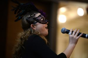 Andrea Ingraham singing an aria to guests during the 18th annual 4-A-Child Masquerade Ball, a benefit of the California Parenting Institute held Saturday evening at the DeTurk Round Barn in Santa Rosa. November 8, 2014.  (Photo: Erik Castro/for The Press Democrat)