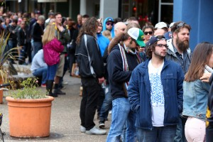 Customers wait in line for hours along Fourth Street in downtown Santa Rosa for the 2014 release of Pliny the Younger at Russian River Brewing Company. (Christopher Chung/ The Press Democrat)