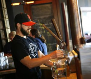 Josh Hamilton pours a beer for the Friday crowd at Fogbelt Brewing Company in Santa Rosa. (photo by Connor Jay)