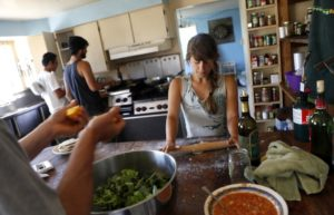 Interns make lunch in their house at Green String Farm in Petaluma. (photo by Beth Schlanker)