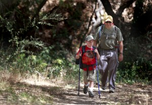 Ari Castaneda, 8, and his dad, Paul, hike towards an overnight campground where they will be spending the night at Hood Mountain Regional Park in Kenwood. (Photo by Beth Schlanker)