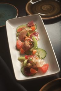 "The ""Raw Fish of the Day"" is the chef's selection. This day it included cucumbers and blood oranges."