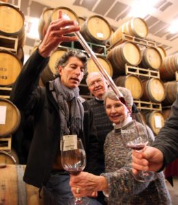 Mazzocco Winery winemaker Antoine Favero, from left, does a barrel tasting with Darrel Bihr and Carol Bihr (Crista Jeremiason / PD FILE)