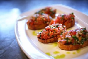 Bruschetta all'Aglio, Pomodoro e Basilico is served at Baci Cafe & Wine Bar in Healdsburg. (Photo by Conner Jay)