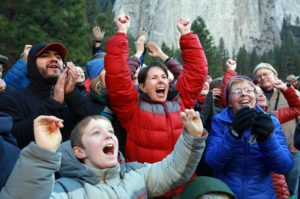 Gaelena Jorgeson, center in red, of Santa Rosa celebrates as her son, Kevin, completes the first free climb of El Capitan in the Yosemite Valley on Wednesday. Terry Caldwell, right, mother of Jorgeson's climbing partner Tommy Caldwell, and her grandson Grant Van Nieuwenhuysen, 12, join the jubilation in the meadow. (John Burgess / The Press Democrat)