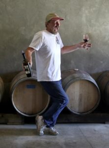 Richard Kasmier, owner/winemaker/cellar worker for the tiny KAZ Winery, dazzles his guest with a dance while pouring newer wines as part of the Savor Sonoma Valley weekend. (photo by John Burgess)
