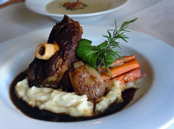 Kitchari Spiced Boneless Lamb Shank with Banyuls Shallots, Heirloom Carrots, Potato Puree and Mache Greens. The Parsnip-White Bean Soup with Porcini Beignets, Meyer Lemon Drizzle, Pea Shoot & Almond Gremolata. The Village Inn & Restaurant in Monte Rio overlooking the Russian River; Serving dinner Wed.-Sun.; Bar opens at 3PM, Dinner service starts at 5PM. Reservations 707-865-2304; www.villageinn-ca.com