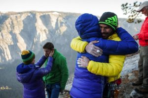 From left: Becca and Tommy Caldwell, and Jacqui Becker and Kevin Jorgeson embrace after the two men completed a free climb summit of the Dawn Wall of El Capitan, in Yosemite National Park, Calif., Jan. 14, 2015. Using ropes as a safety measure only, the duo became the first to climb by hand the 3,000-foot granite wall, an ascent they began on Dec. 27. (Max Whittaker/The New York Times)